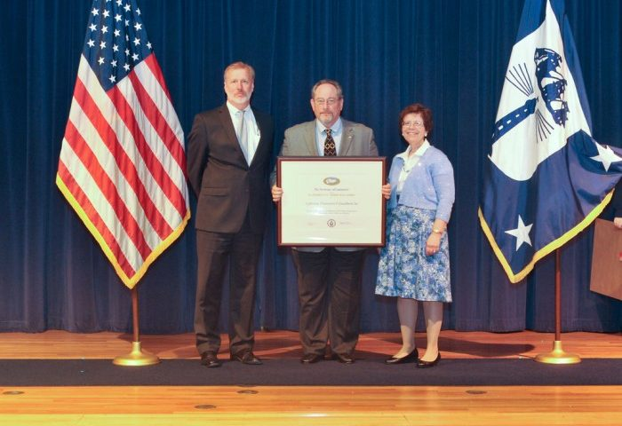 "CEO Avram Saunders accepting the President's ""E"" Award for Lightning Protection Exports"